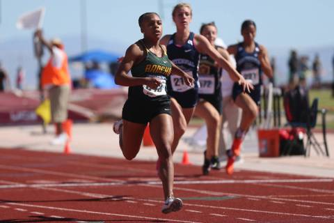Rancho's Amir'a Edmond (843) runs for first place, followed by teammate Aniya Smith (843), and ...
