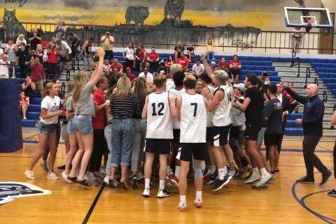 Coronado players celebrate with their fans after the Cougars defeated Arbor View, 19-25, 25-20, ...