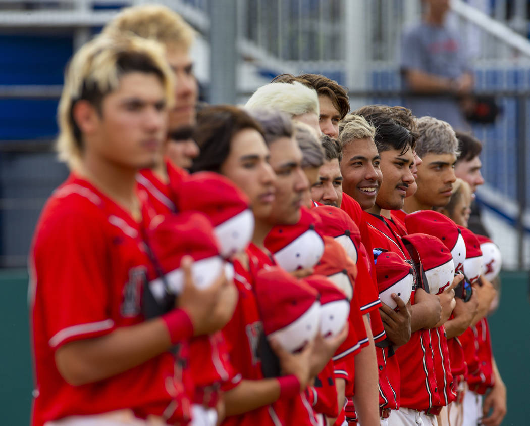 Las Vegas players stand for the National Anthem versus Reno during their state baseball tournam ...