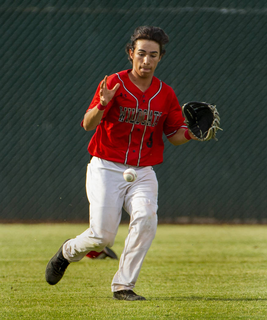Las Vegas' Jose Martinez (9) eyes a short bounce in the outfield versus Reno during their state ...