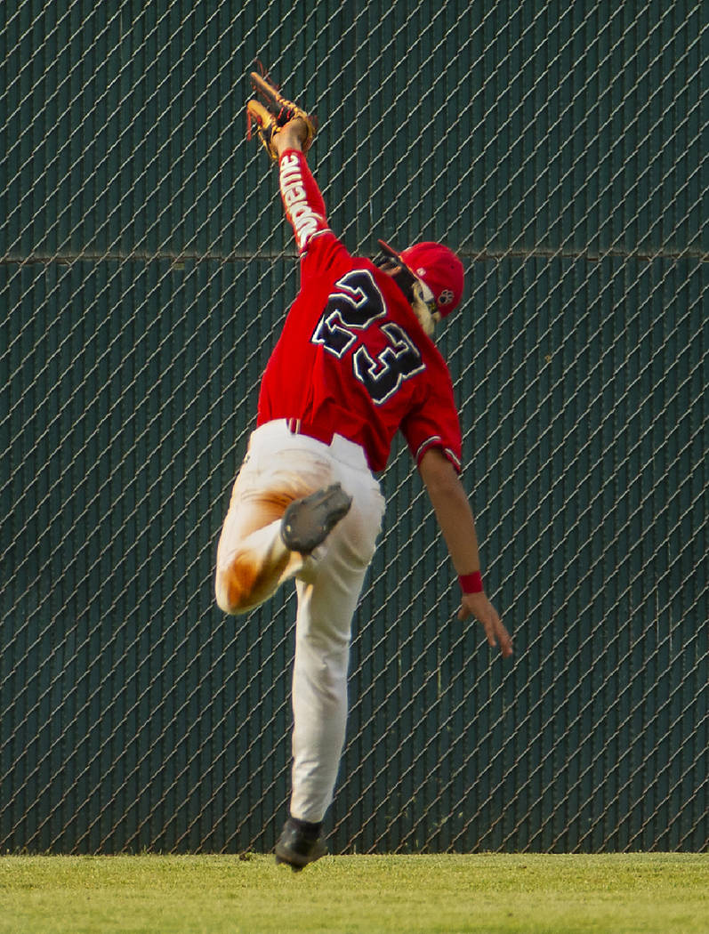 Las Vegas' Dalton Silet (23) extends in the air to catch a long, fly ball in the outfield versu ...