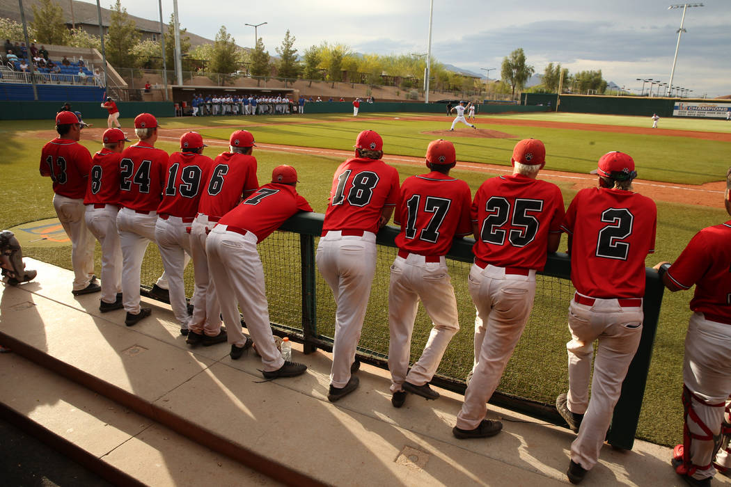 Las Vegas players cheer teammates from the dugout versus Reno during their state baseball tour ...