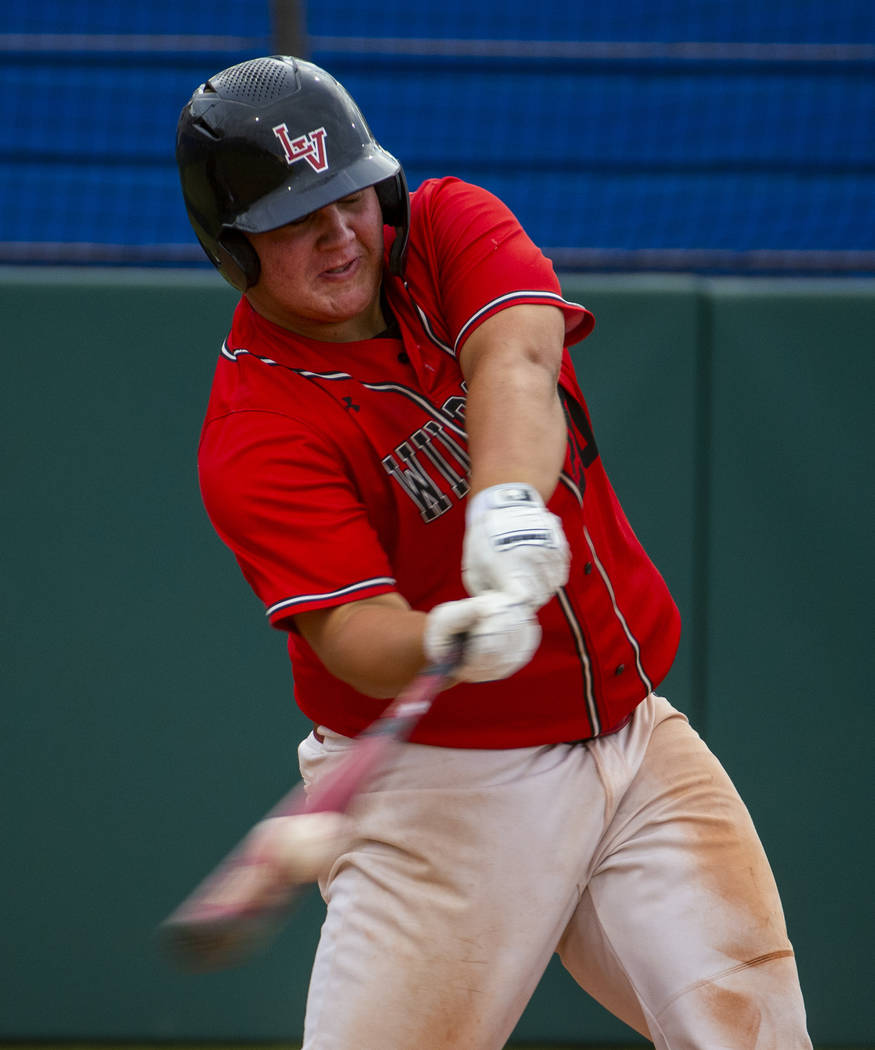 Las Vegas' Trevor Johnson (20) connects on a hit versus Reno during their state baseball tourna ...