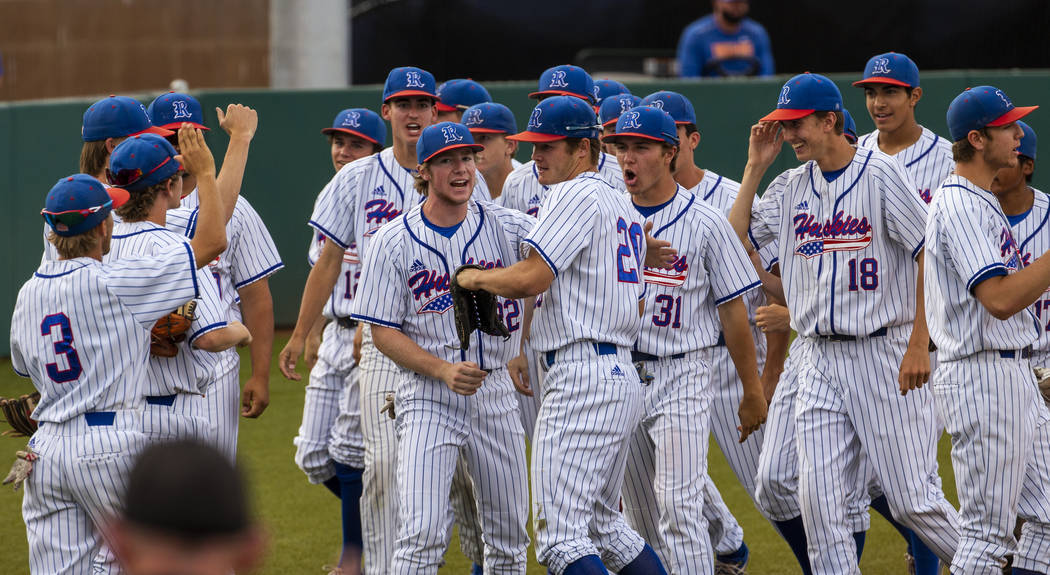 Reno players celebrate another run and a dominating score versus Las Vegas during their state b ...