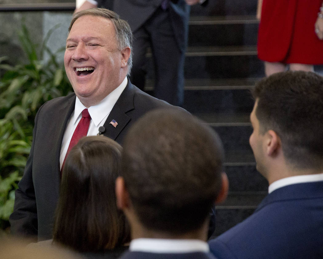 Secretary of State Mike Pompeo smiles while meeting employees after announcing a new 'ethos' st ...