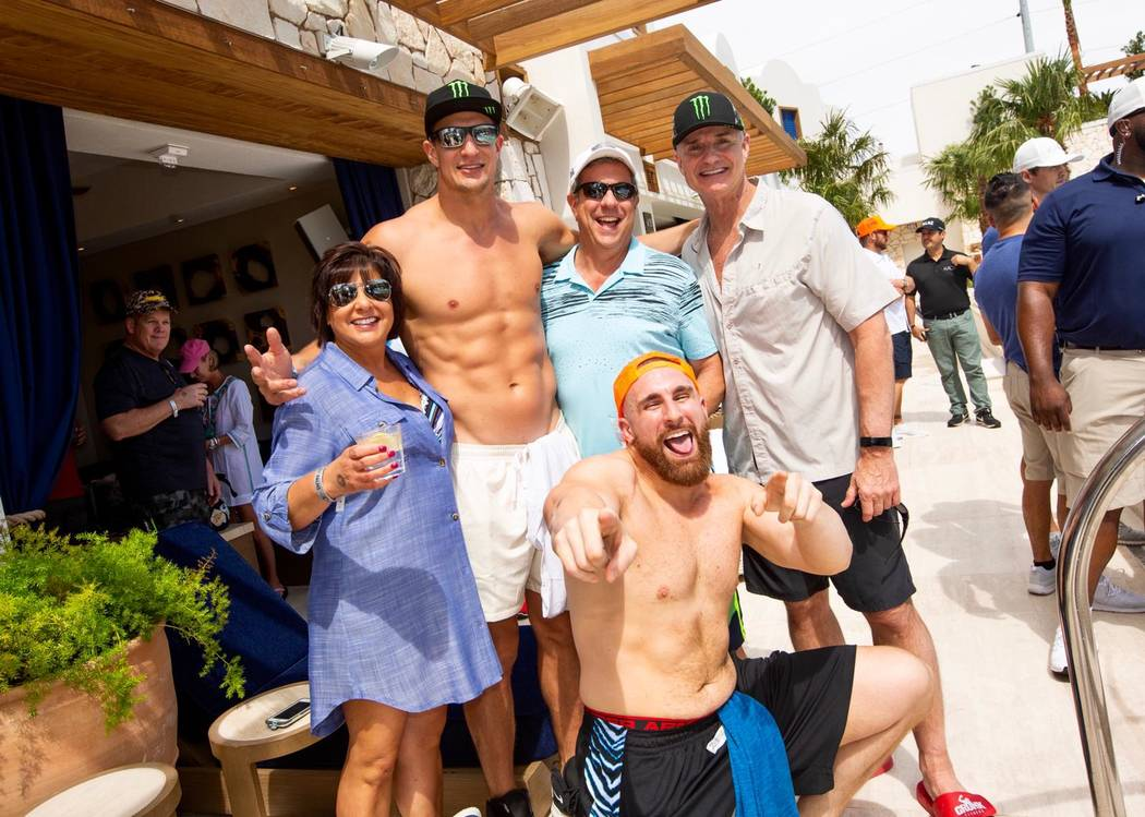 """Rob Gronkowski and Dean """"Mojo Rawley"""" Muhtad are shown with Gronk's friends and family memv ..."""
