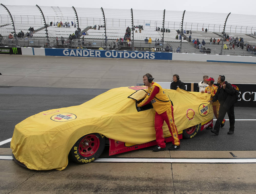The team of Joey Logano pushes his car off of pit road after a NASCAR Cup Series auto race was ...