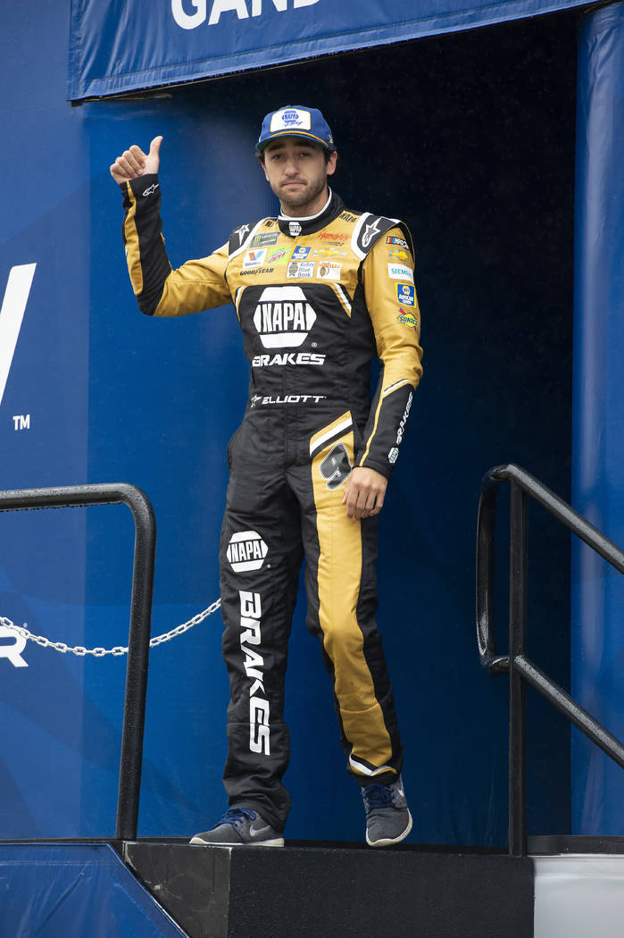 Chase Elliott gives a thumbs-up during driver introductions at a NASCAR Cup Series auto race Su ...