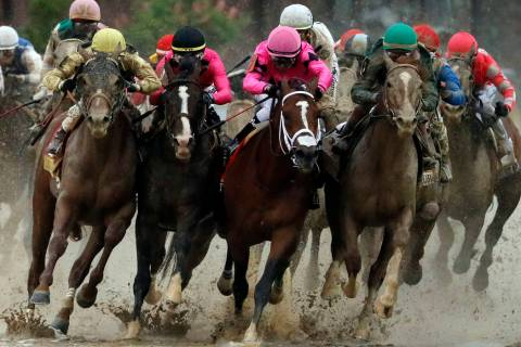 Flavien Prat on Country House, left, races against Luis Saez on Maximum Security, third from le ...