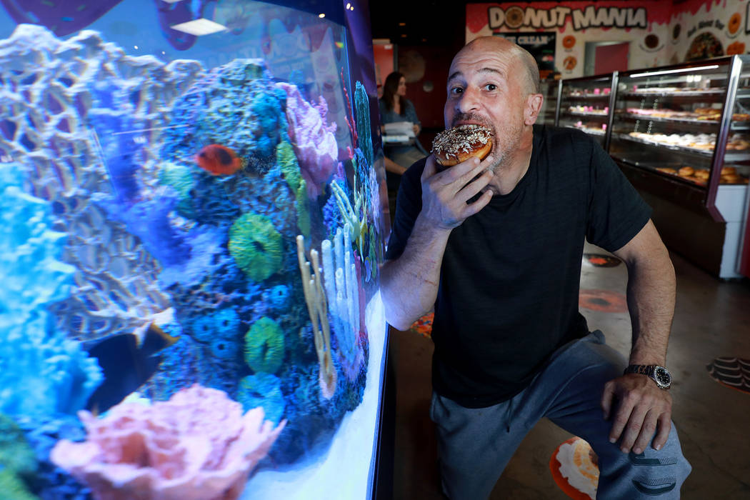 """Brett Raymer, a star of the TV show """"Tanked"""" and owner of Donut Mania, at his shop in Las Vegas ..."""