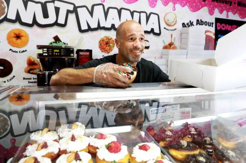"Brett Raymer, a star of the TV show ""Tanked"" and owner of Donut Mania, at his shop in Las Vegas ..."