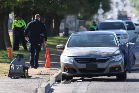 Henderson police investigate after a man in a motorized wheelchair was hit by a vehicle at Boul ...