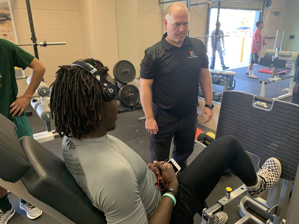 Jeffrey Taormina works with a student athlete during his physical therapy class on May 2.(Mia S ...