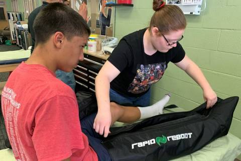 Students in Jeffrey Taormina's peer sports medicine class treat student athletes to gain hands- ...