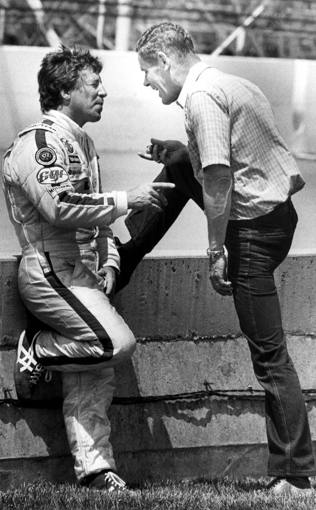 FILE - In this May 11, 1982, file photo, 1981 Indy 500 winner Bobby Unser, right, talks with 19 ...