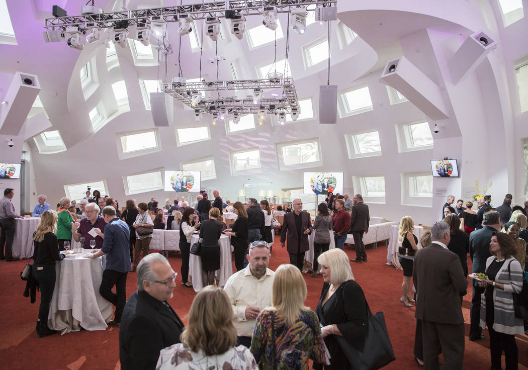Guests fill the Cleveland Clinic Lou Ruvo Center for Brain Health for a reading and book signin ...