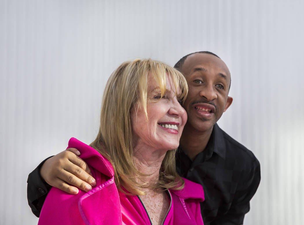 Author Linda Smith, left, takes a photo with Reggie Daniel during a reading and book signing f ...