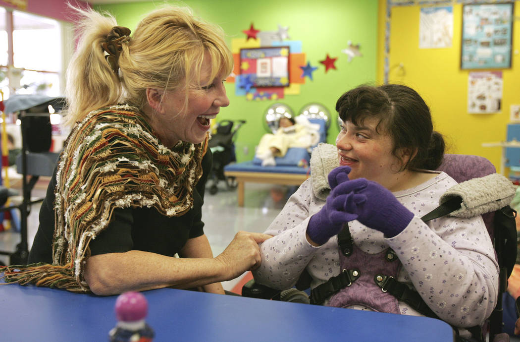 SW-SP/VIEW--Linda Smith, chief development officer, left, interacts with Tiffany Hobbs, 25, at ...
