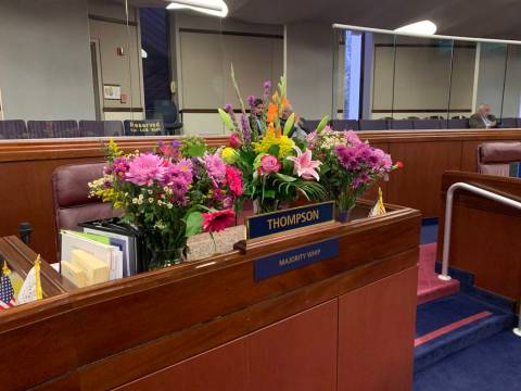 Flower bouquets in memory of Assemblyman Tyrone Thompson were placed on his desk in Assembly ch ...