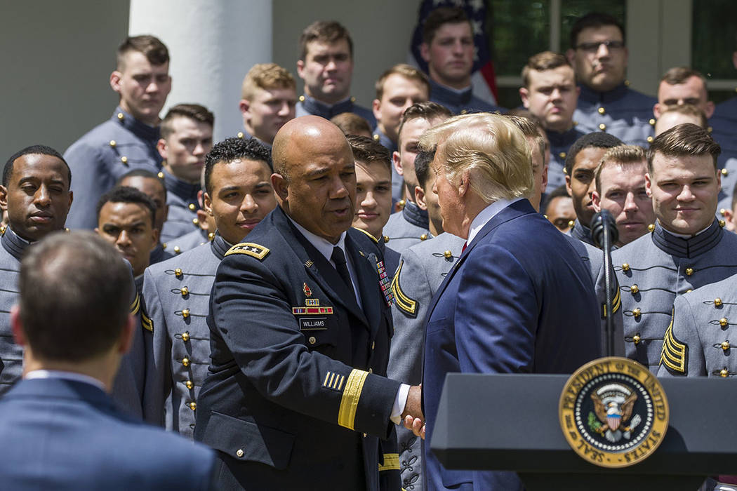 West Point Superintendent Lt. Gen. Darryl Williams, center, shakes hands with President Donald ...