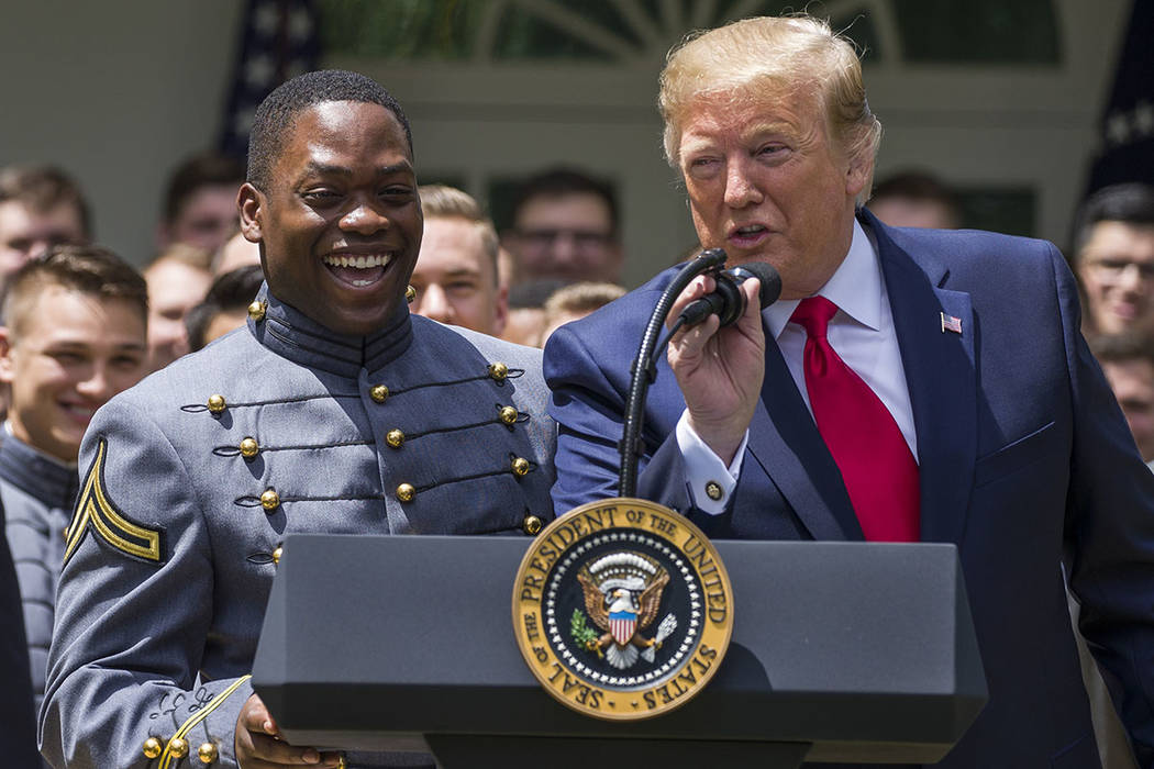 President Donald Trump speaks to introduce Army quarterback Kelvin Hopkins Jr., during the pres ...