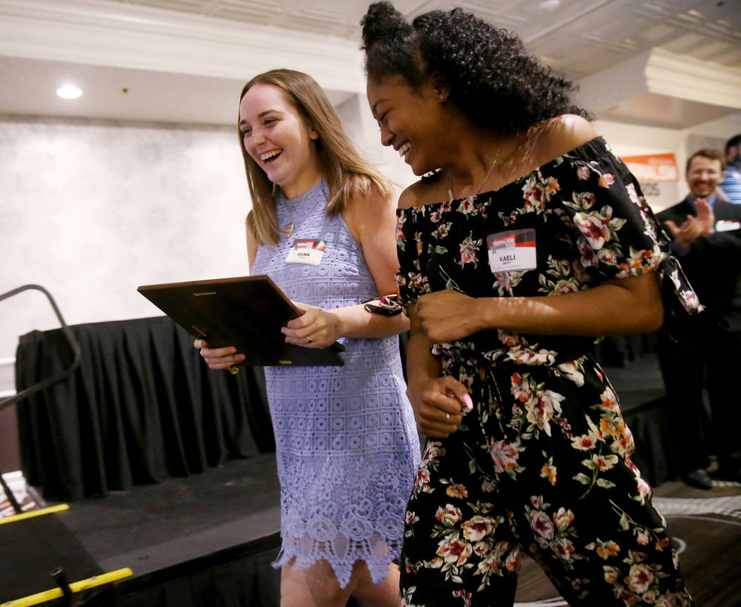 Erinn Veach, left and Kaeli Britt, editors of the Green Valley High School newspaper, The Inves ...