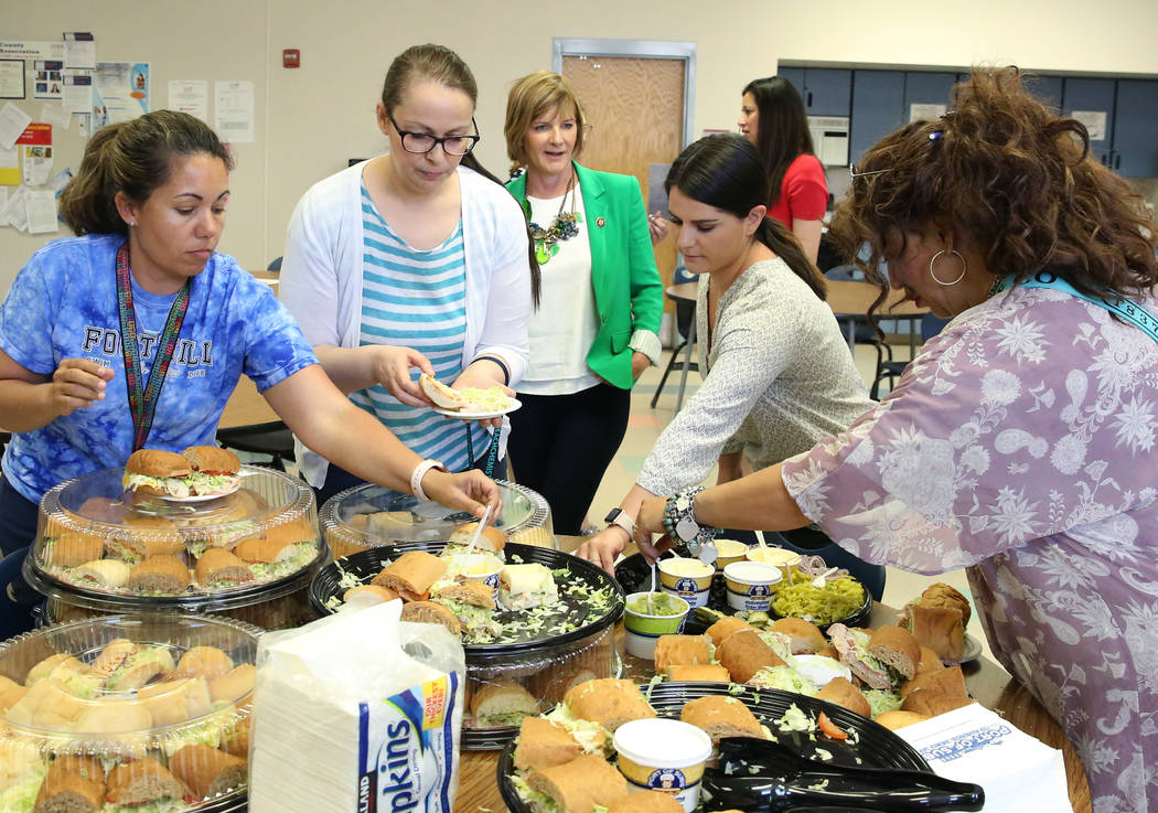 Rep. Susie Lee, D-Nev., center, chats with teachers after delivering lunch on Monday, May 6, 20 ...