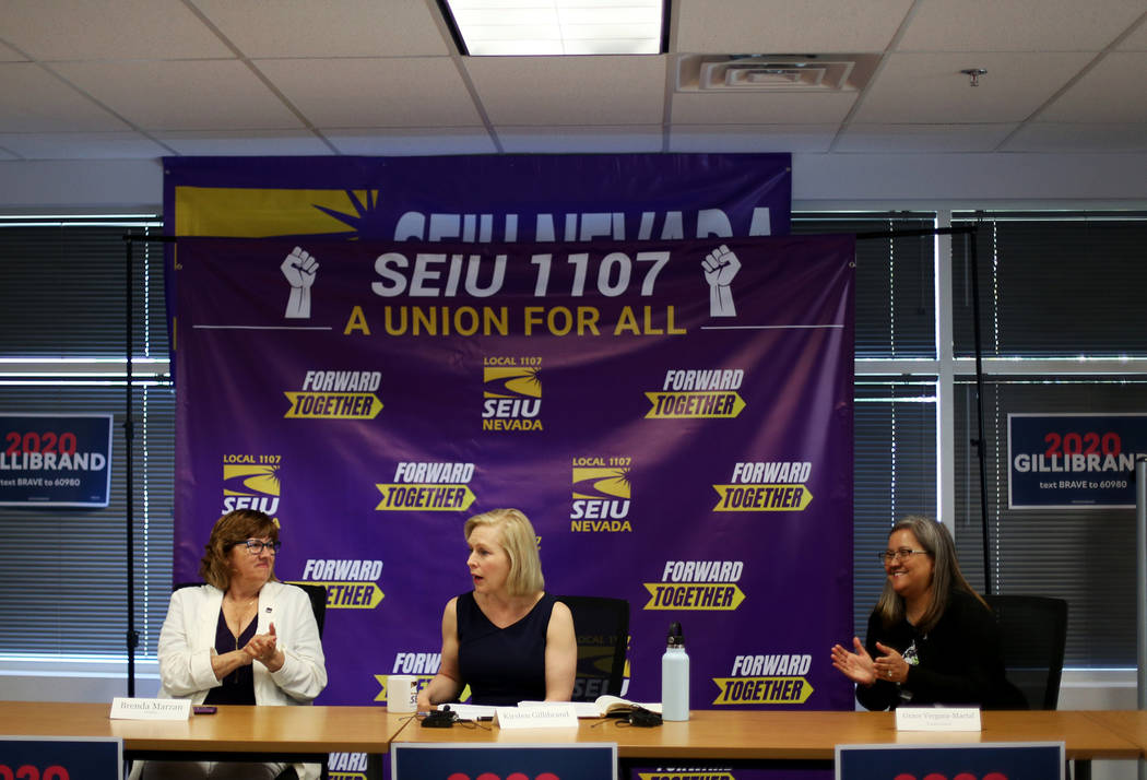 Democratic presidential candidate Sen. Kirsten Gillibrand, center, is applauded by SEIU Local 1 ...
