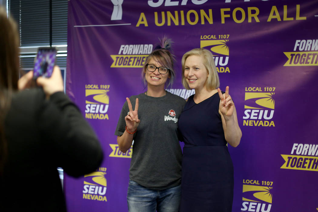 Democratic presidential candidate Sen. Kirsten Gillibrand takes a photo with Darla Garcia after ...
