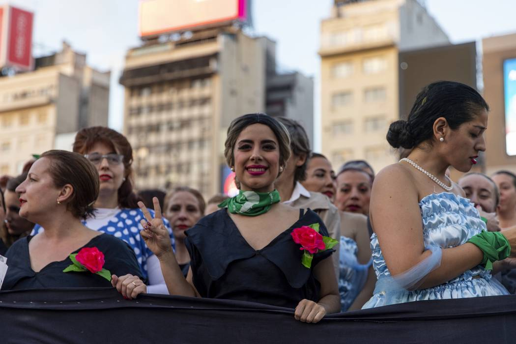 Women dressed as Eva Peron parade down the streets of Buenos Aires, Argentina, Monday, May. 6, ...