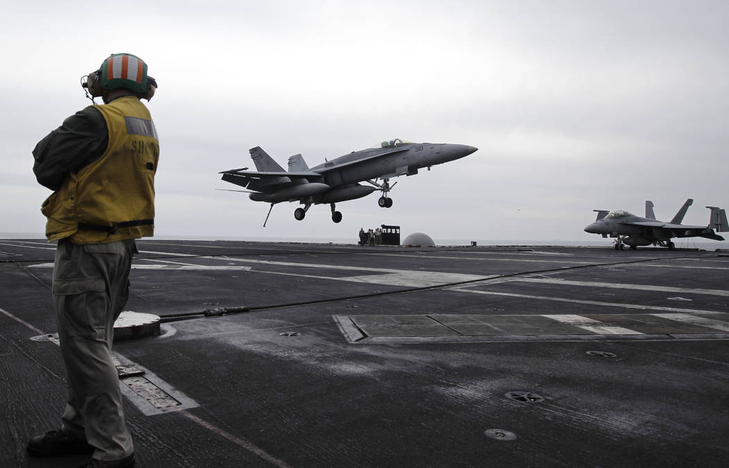 FILE - In this Feb. 13, 2012, file photo, a U.S. fighter jet lands on the USS Abraham Lincoln a ...