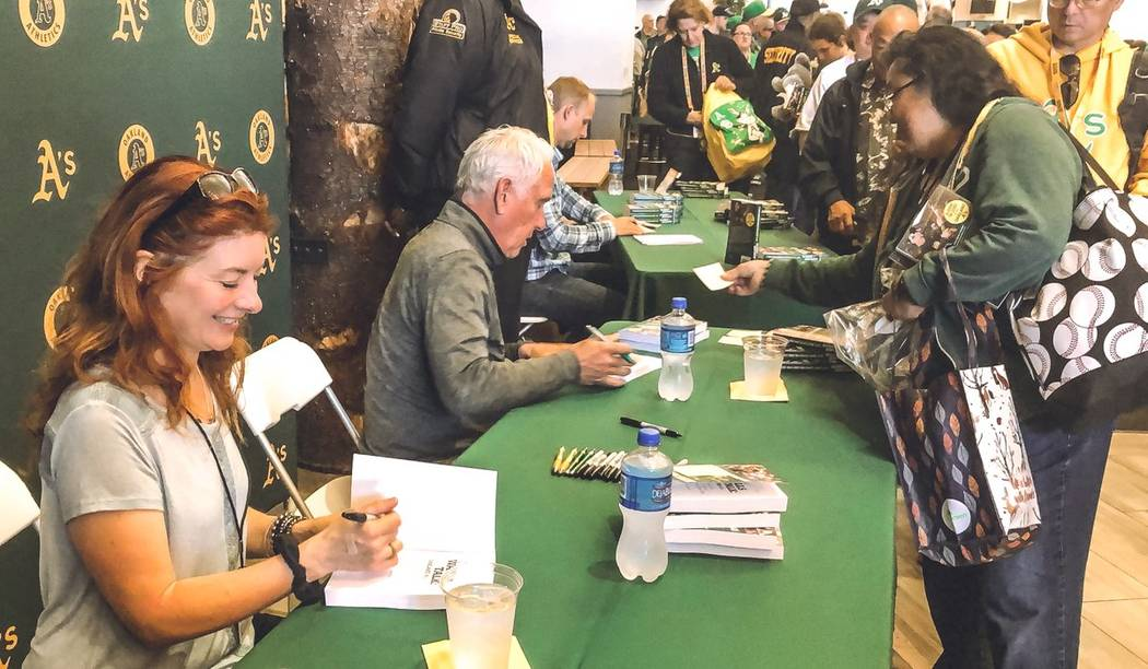 Oakland A's beat writer Susan Slusser of the San Francisco Chronicle, left, and Henderson resid ...