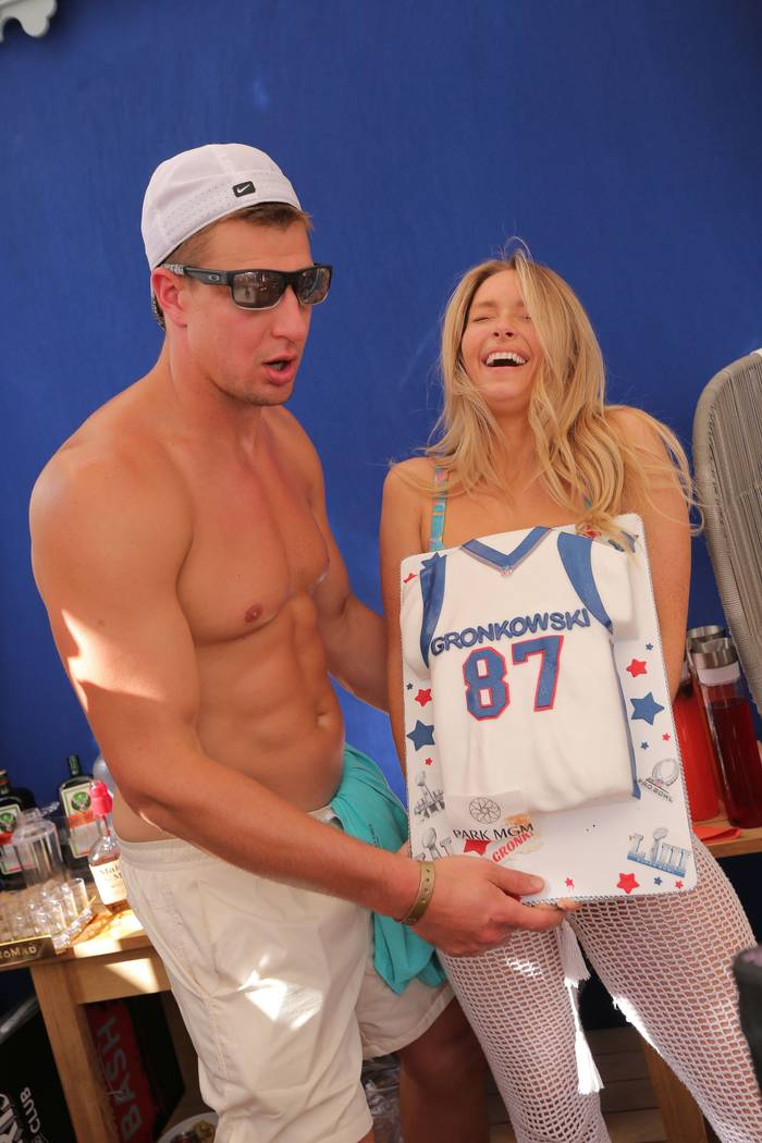 Ex-New England Patriots tight end Rob Gronkowski and his girlfriend, Camille Kostek, are shown ...