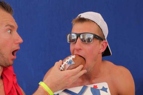 Ex-New England Patriots tight end Rob Gronkowski devours a celebratory retirement cake at Jemma ...