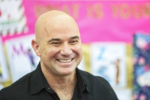 Andre Agassi shares a laugh during an event at Andre Agassi Preparatory Academy in February. ( ...