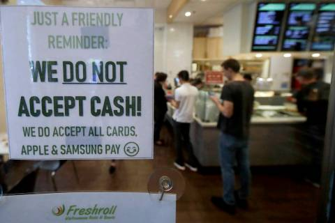 A sign posted on a door May 2, 2019, alerts customers that cash is not accepted at Freshroll Vi ...
