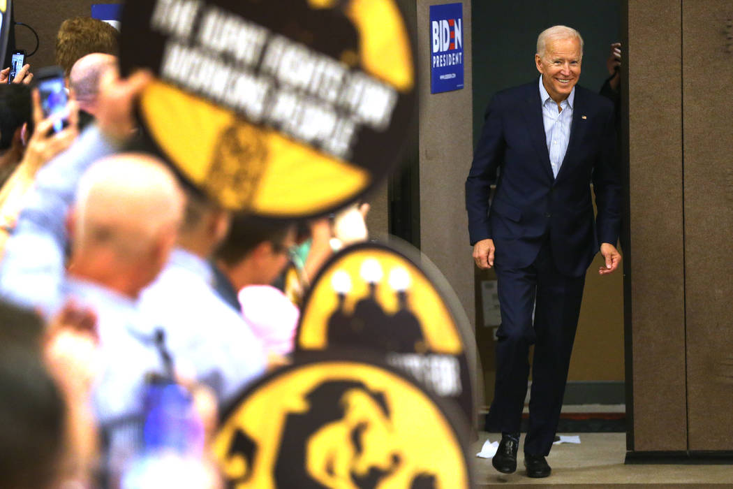 Democratic presidential candidate Joe Biden speaks enters the room for a campaign stop at the I ...