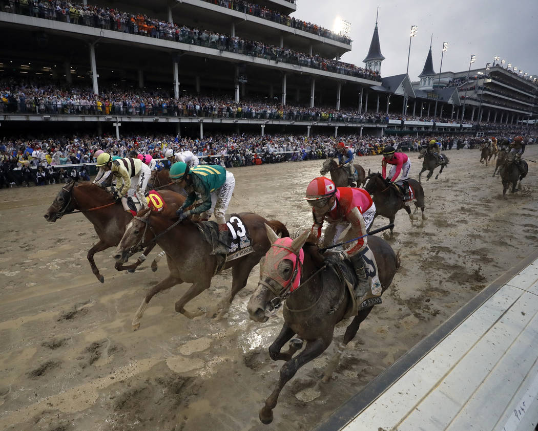 Flavien Prat ride Country House, left, to the finish line during the 145th running of the Kentu ...