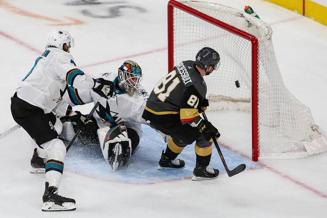 Vegas Golden Knights center Jonathan Marchessault (81) scores against San Jose Sharks goaltende ...