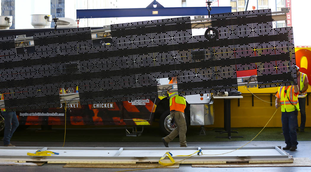 Construction workers prepare to installl a new panel during the second day of renovations of th ...