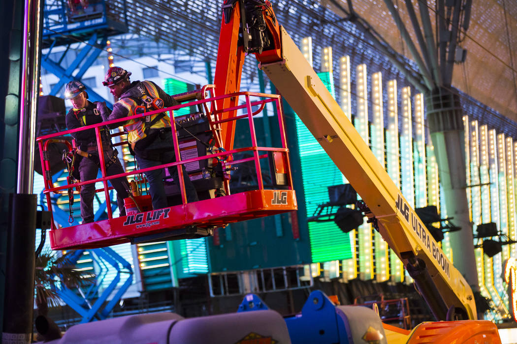 Construction use a lift during the second day of renovations of the Viva Vision canopy along th ...