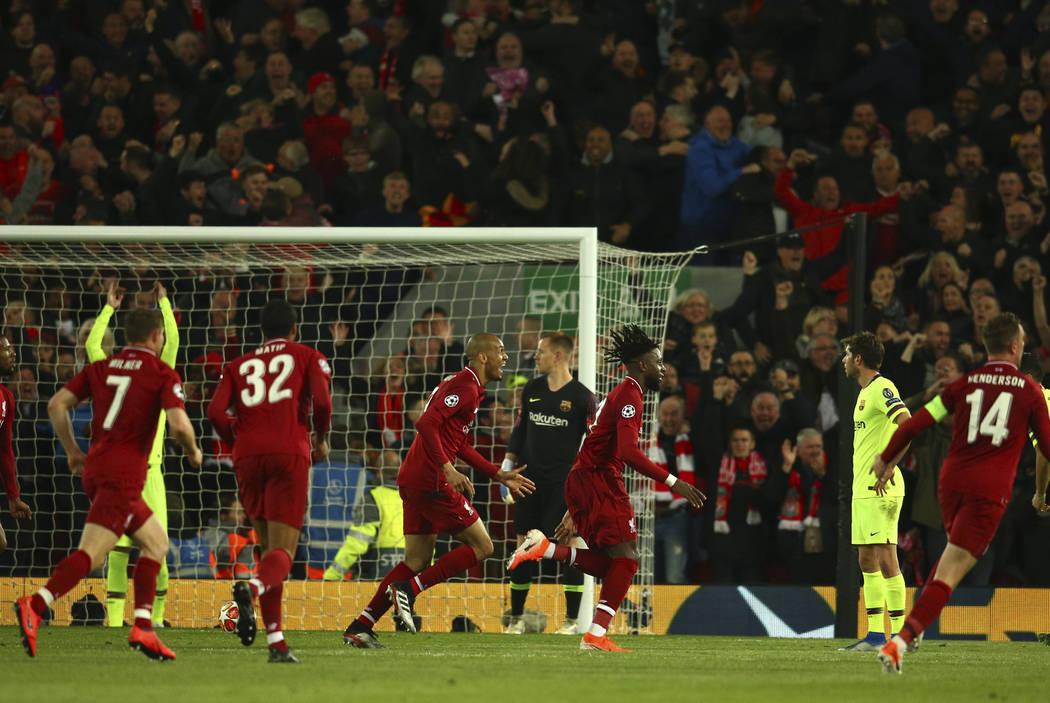 Liverpool's Divock Origi celebrates scoring his side's 4th goal during the Champions League sem ...