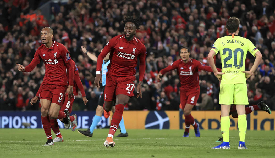 Liverpool's Divock Origi, center, celebrates scoring his side's fourth goal of the game during ...