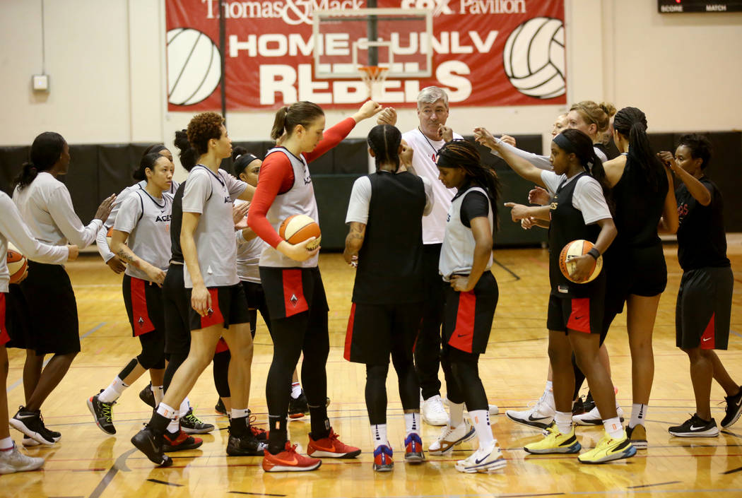 Aces coach Bill Laimbeer gathers his players during practice at Cox Pavilion in Las Vegas Wedne ...