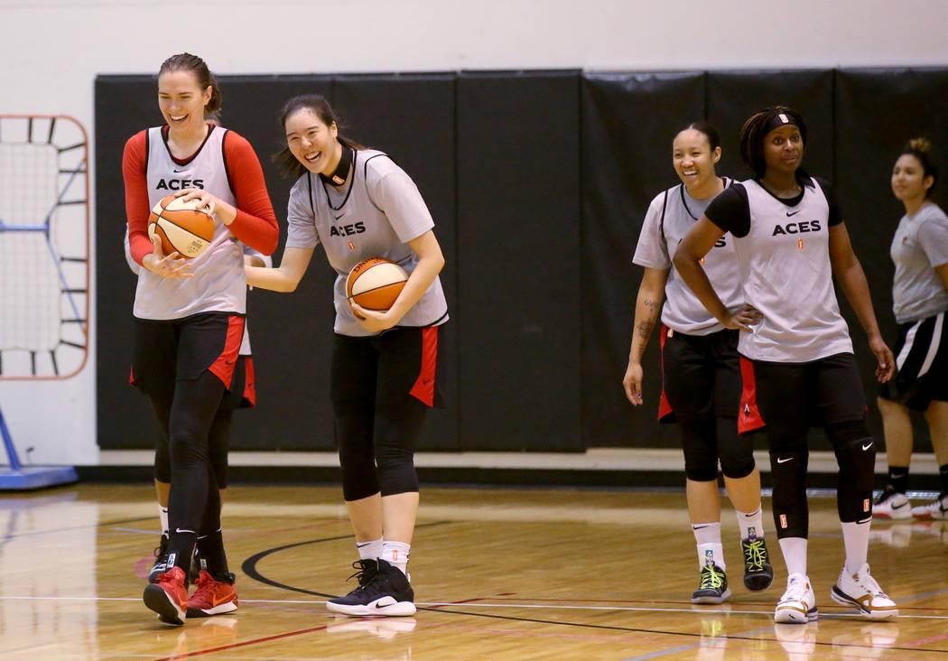 Aces center Ruth Hamblin, left, jokes with teammates, from second from left, JiSu Park, Saniya ...
