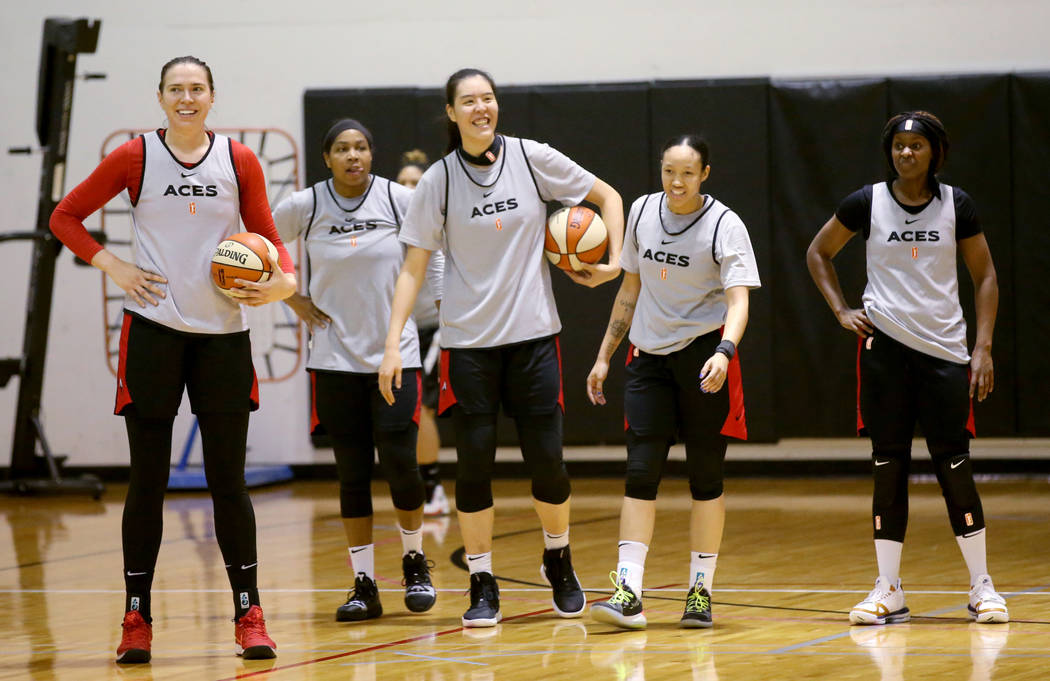 Aces center Ruth Hamblin, left, with teammates, from second from left, Alex Harden, JiSu Park, ...