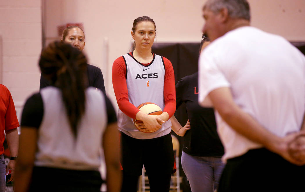 Aces center Ruth Hamblin gets instruction from coach Bill Laimbeer during practice at Cox Pavil ...