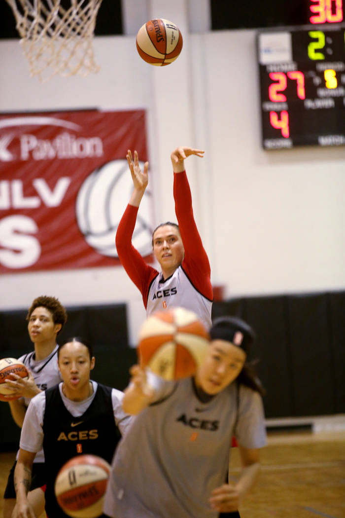 Aces center Ruth Hamblin, left, shoots with teammates during practice at Cox Pavilion in Las Ve ...