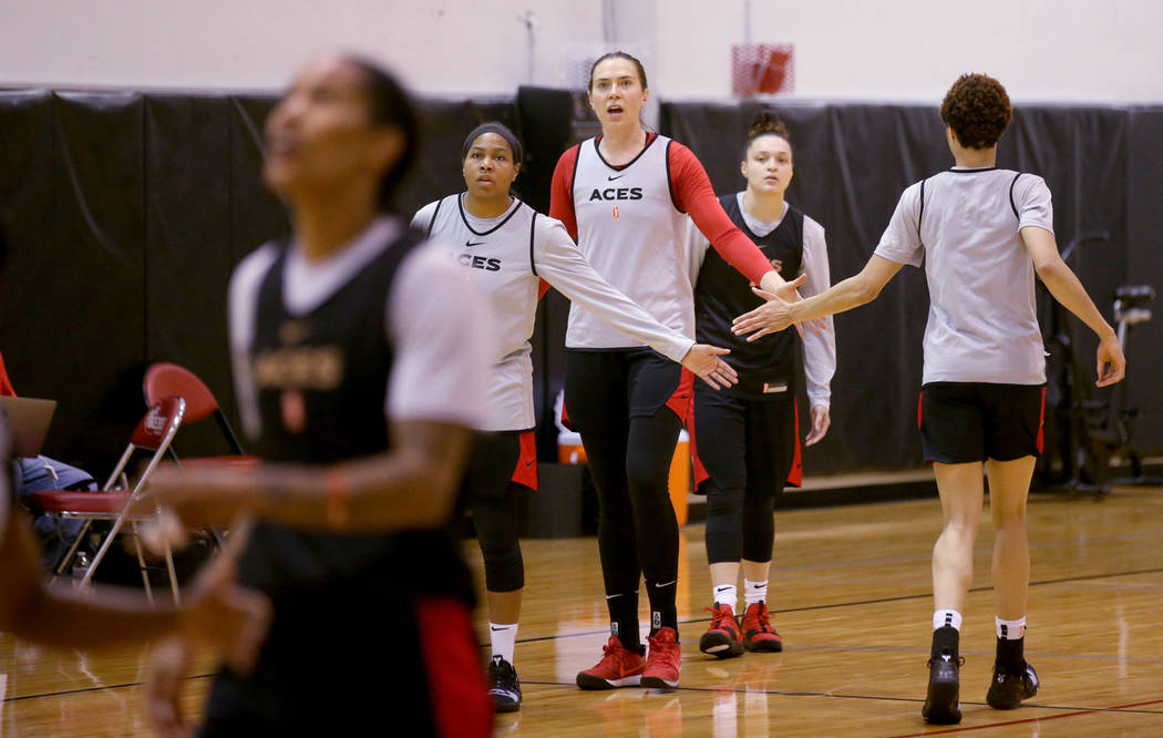 Aces center Ruth Hamblin, center, fires up teammates, from left, Alex Harden, Kayla McBride and ...