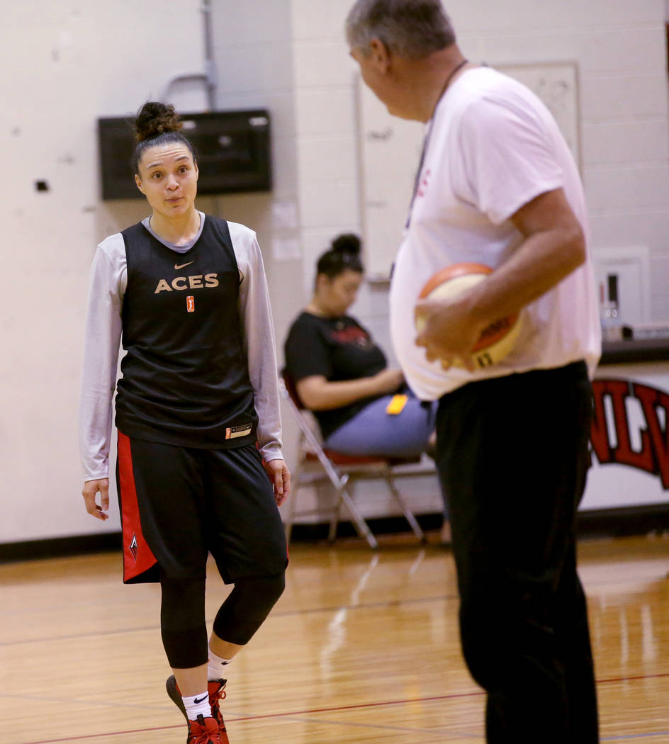 Las Vegas Aces guard Kayla McBride (21) gets instruction from coach Bill Laimbeer during practi ...